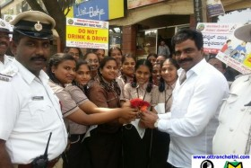Road safety week Roses to Traffic violators at Chamarajet & Banashankari